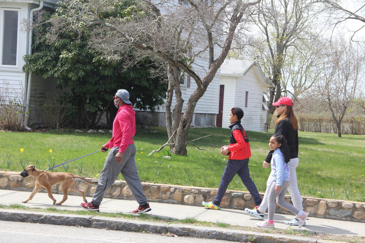 The Simonds-Dickinson family takes a noontime walk on Ocean Avenue in New London on a warm day in April.