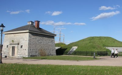 The Fort Trumbull Quest begins at the Blockhouse building, the oldest one at the park. The masts of the Coast Guard Barque Eagle, which is docked at the park, is visible in the background.