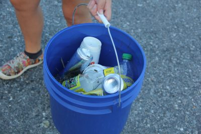 One of the volunteer's buckets is filled with bottles, cans and Styrofoam cups about 90 minutes into the cleanup.