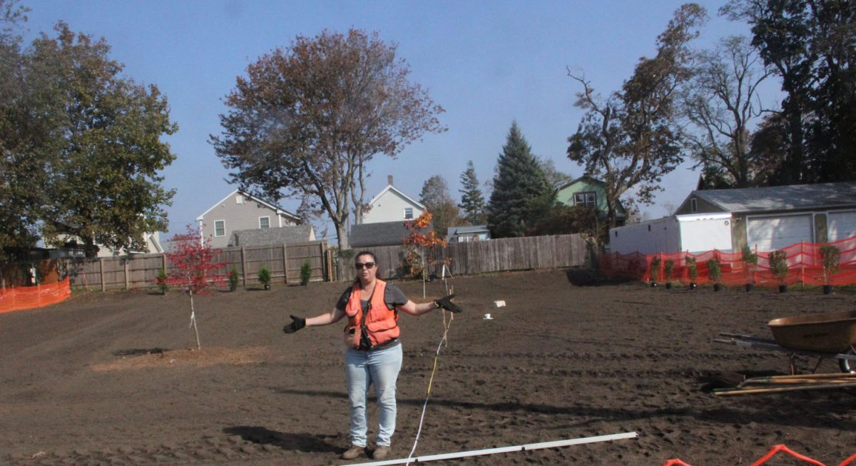 Kristin Walker, project engineer for the USDA's Natural Resource Conservation Service, explains how the former home site is now being planted with native species to create a flood plain habitat.