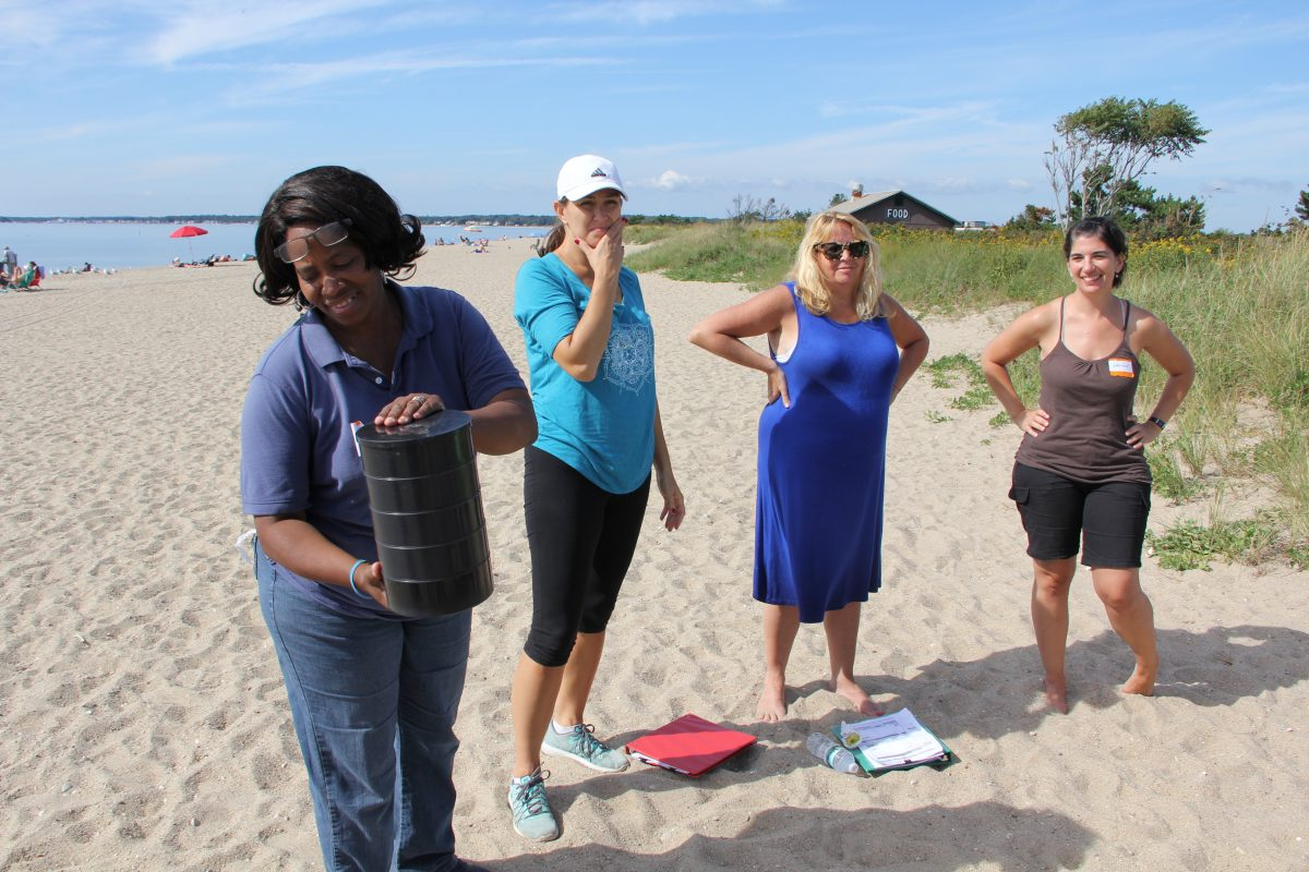 Participants in the Long Island Sound Mentor Teacher program learn how to use a sifter for lessons about different types of sand during a workshop at Hammonassett Beach State Park in Madison.