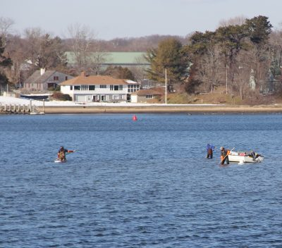 The Niantic River continues to attract clammers even in the winter months. These clammers could be seen from shore on Feb. 6.