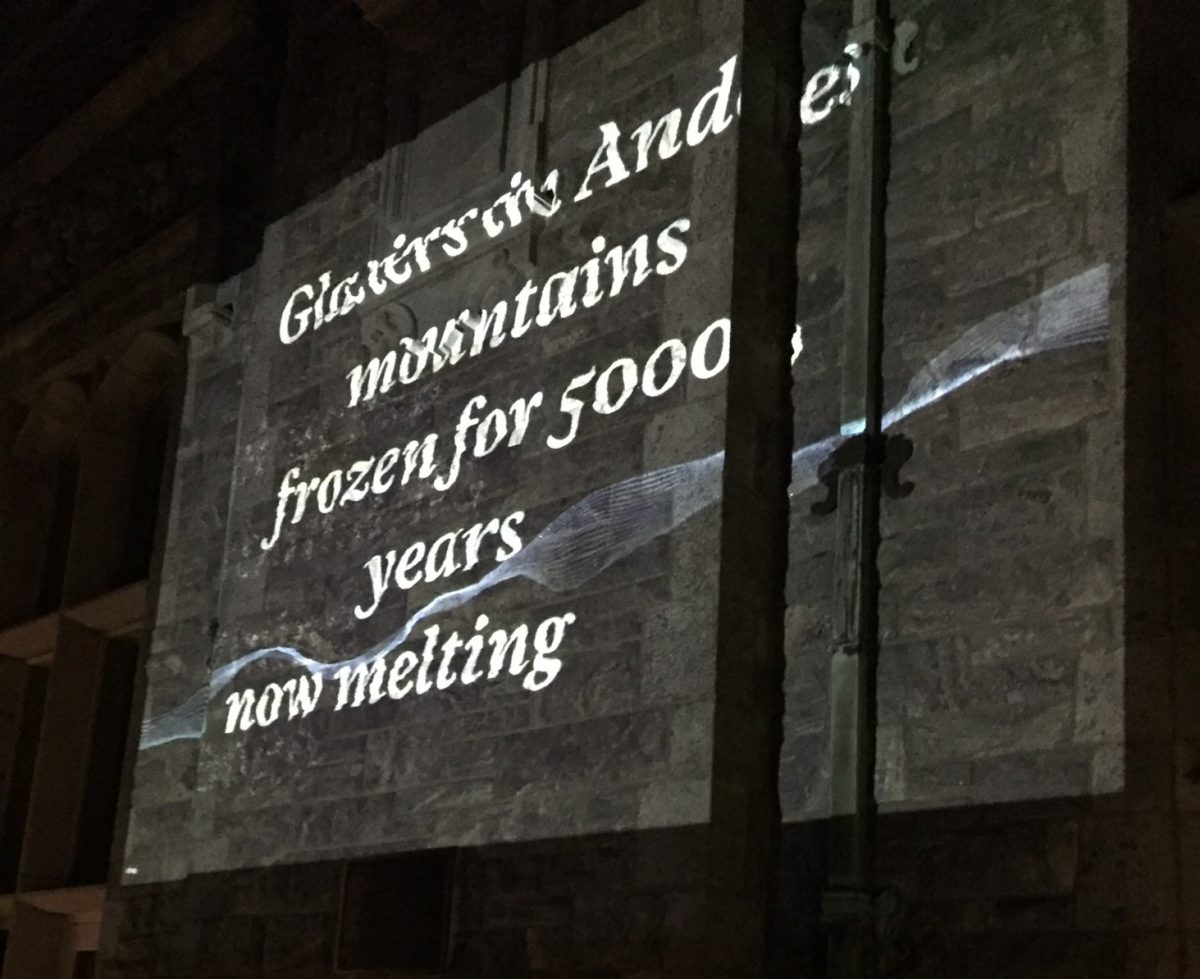 """Image of a """"Reading the Wrack Lines"""" digital audio/video projection on the Branford House at UConn Avery Point."""
