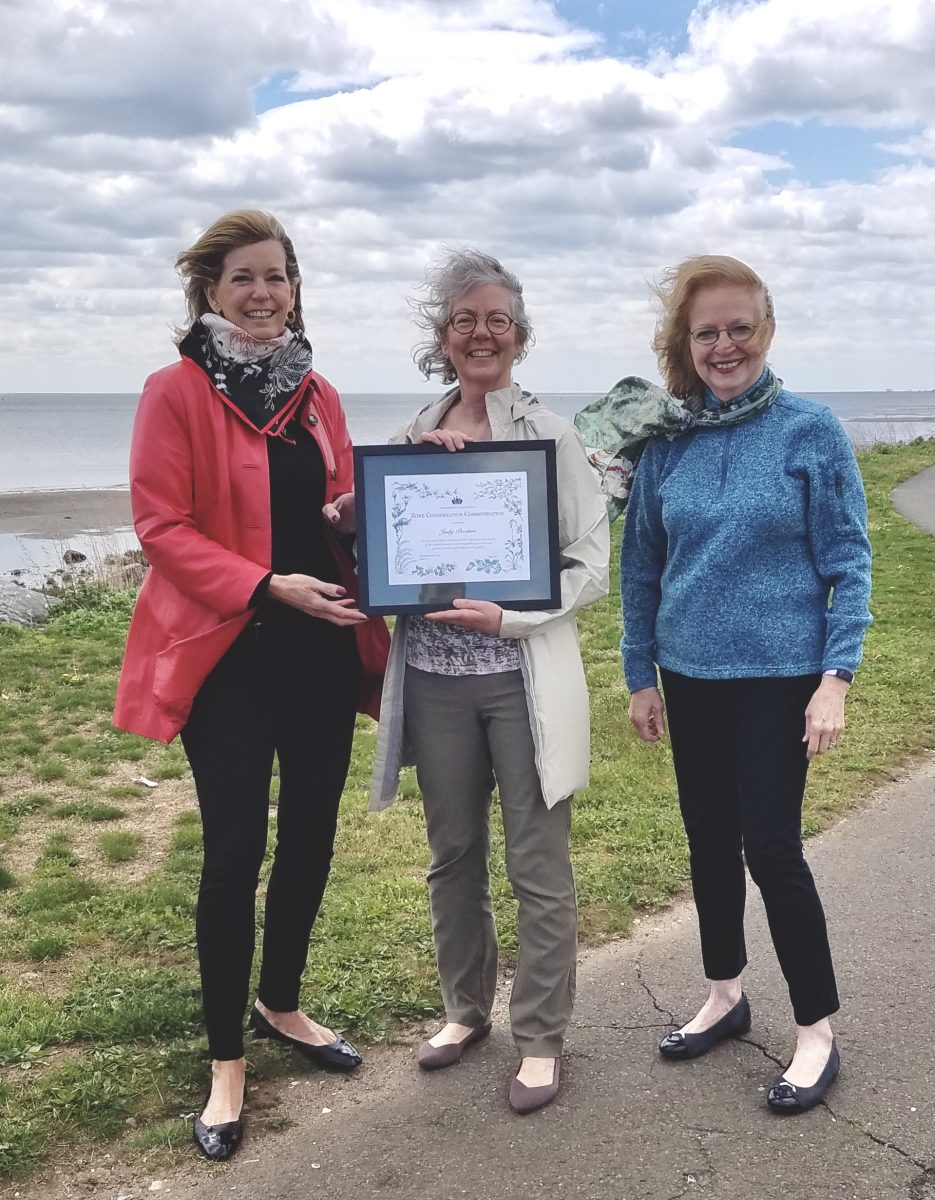 Judy Preston, center, and leaders of the Fairfield Garden Club stand at a site overlooking Long Island Sound after receiving the Garden Club of America Zone Conservation Commendation Award at a ceremony on April 30.