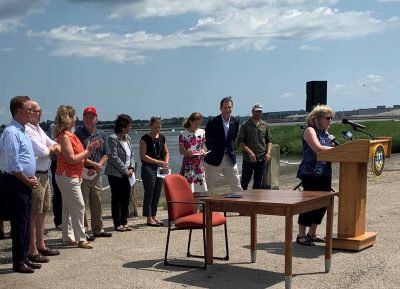 Connecticut Sea Grant Associate Director Nancy Balcom highlights the program's collaborative restoration efforts with the Department of Agricultures during the bill signing ceremony.
