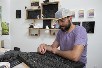 Joseph Smolinski works on a sea coal mosaic in his New Haven studio.