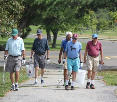 Several members of the Y's Men, a retired men's association in Westport and Weston, were among the more than 25 volunteers who joined the cleanup. Group members walk at the park twice a week.