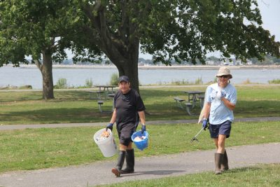 Marc Montillier, left, and Jean-Pierre Montillier of Westport, members of the Y's Men, collected most of the trash they collected from the jetties.