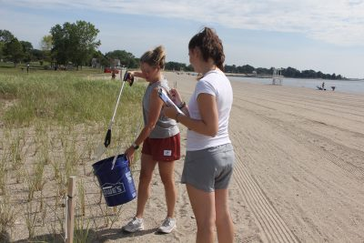 Emma Ofer, left, and Alex Ofer volunteered for the cleanup after they saw it advertised on Facebook.