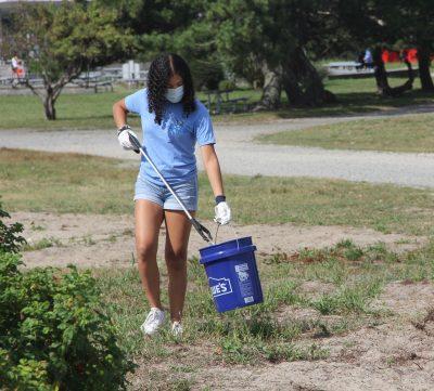 Sophia Garcia of Scarsdale, N.Y., a Maritime Aquarium volunteer, picks up a plastic bottle during the cleanup.