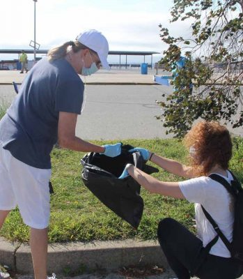 Volunteers Peg Genung of Waterford, left, and Barbara Haid of Meriden picked up dozens of cigarette butts during the cleanup. Cigarette butts were the most numerous item collected by all the groups.