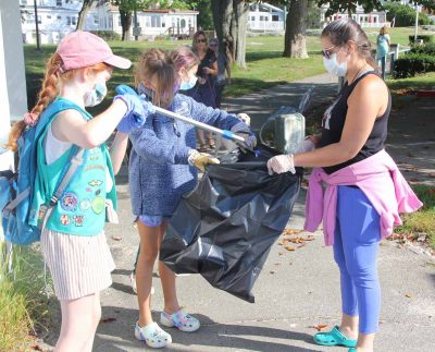 Cheryl Kydd of New London, right, was one of the leaders of the New London Girl Scout troop that volunteered at the cleanup.